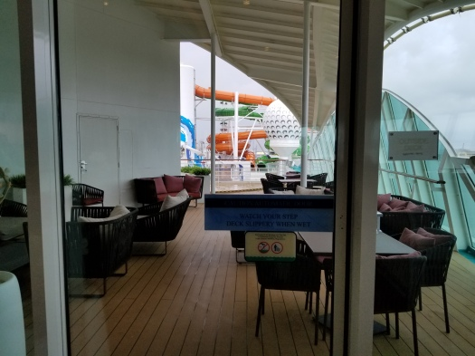 Outdoor space in the Suite Lounge on the Liberty of the Seas.