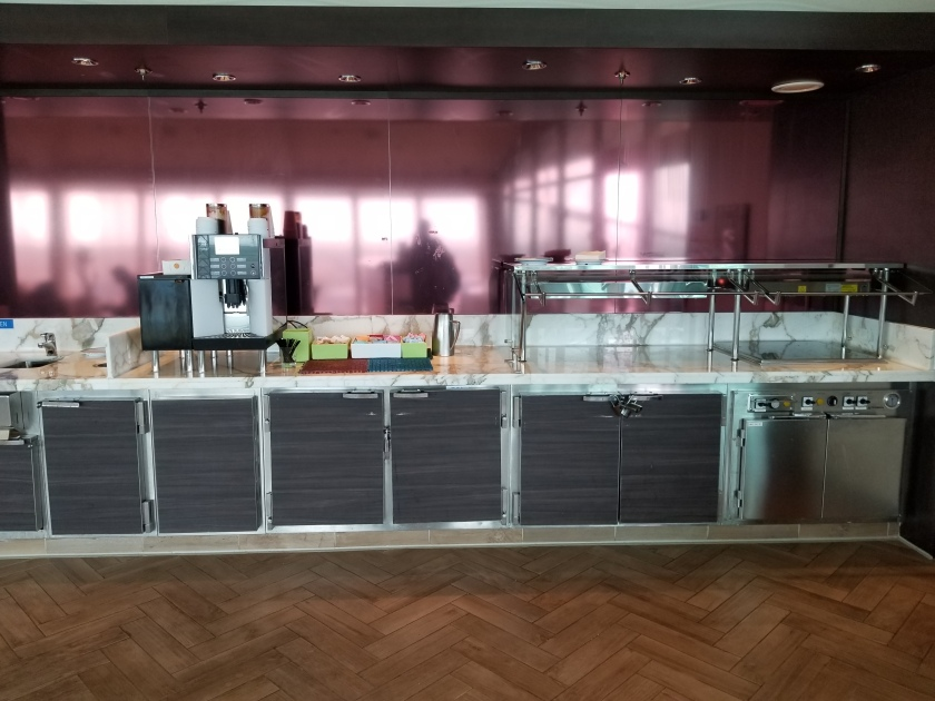 Tea, coffee, and buffet area in the Suite Lounge on the Liberty of the Seas.