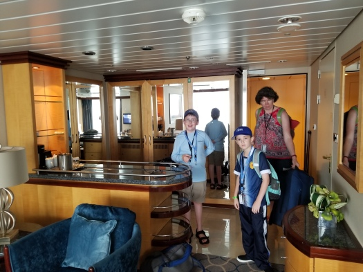 View looking toward the front door of Grand Suite Cabin 1298 on the Royal Caribbean Liberty of the Seas. Wife and kids not included with the cabin. You must bring your own.